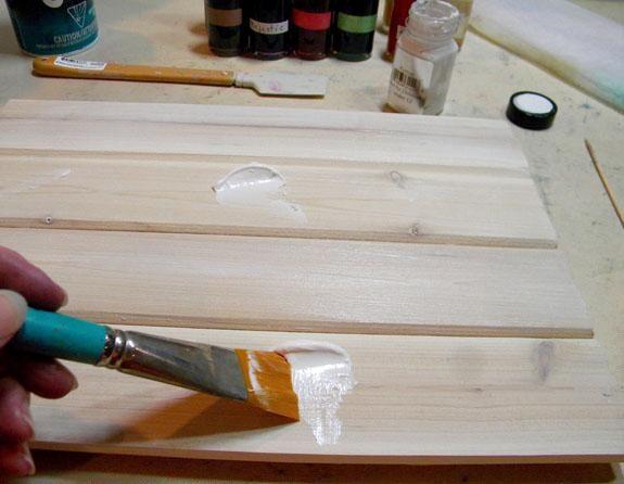 En primer lugar, poner una capa de terciopelo de algodón sobre el sustrato, en este caso, un panel de madera Haré de ti un signo Feliz Año Nuevo.