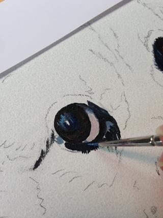Hurley está mostrando el blanco de sus ojos, pero si se estudia la foto que'll notice the
