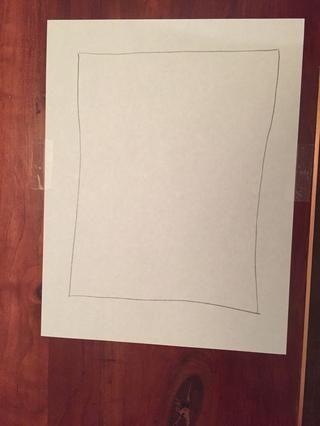 Dibuje un rectángulo en el papel para dar a su pintura una frontera.