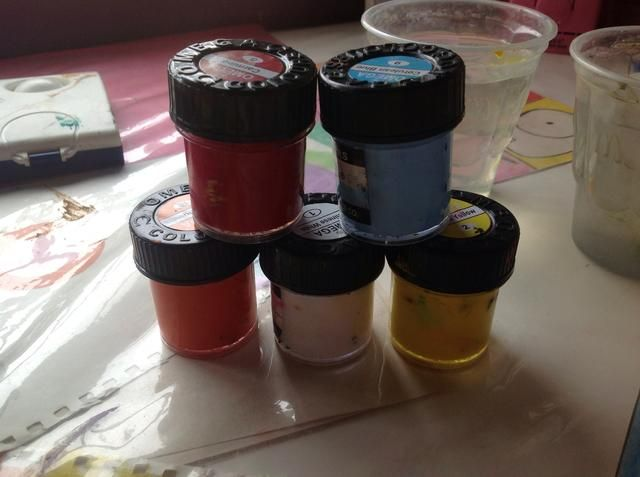 usted'll be needing yellow, orange, red, blue and white paints. Its up to you if you want to use poster paints or watercolours.