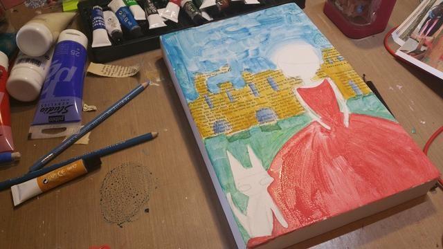 Ahora añadir con sus lápices de colores de agua soluble y el acrílico amarillo ocre pintar una capa que's a little splotchy on the book pages. think of shadow areas on the walls.