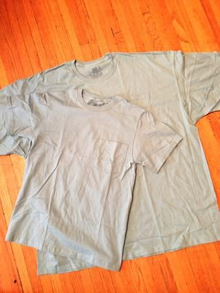 Escoja 2 T's for this project. These are sizes S and a 4XL. The smaller T should fit your shoulders nicely.