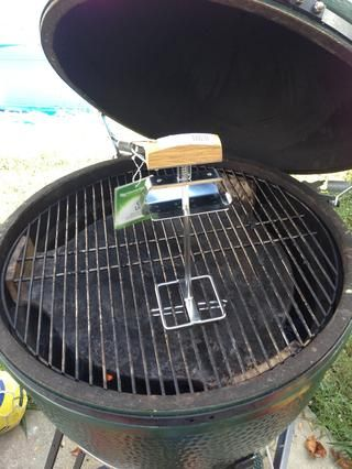 si tu're a water pan type of smoker, put your water pan on the platesetter and then put your grate on the grill.