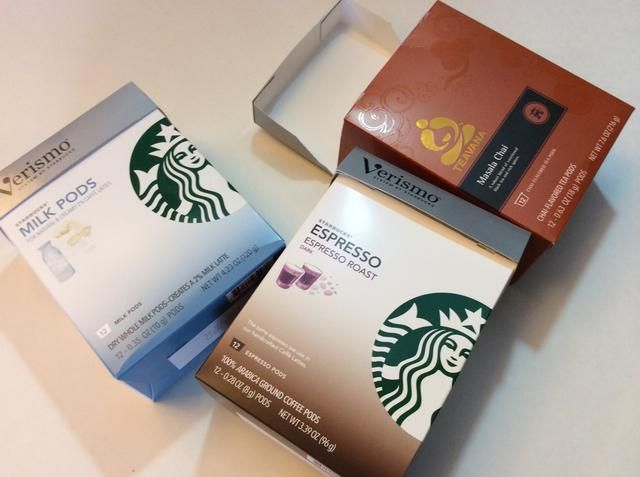 Cajas de vainas de café vacías son el tamaño perfecto y la forma ... cualquier caja pequeña con una tapa funcionará sin embargo.
