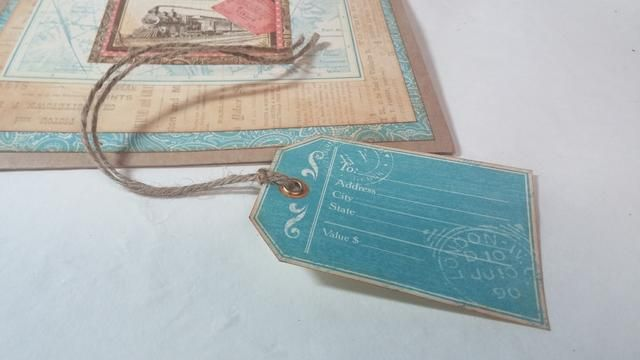 Crear una etiqueta de regalo con un cordel y papel. También me reforcé el orificio con un ojal.