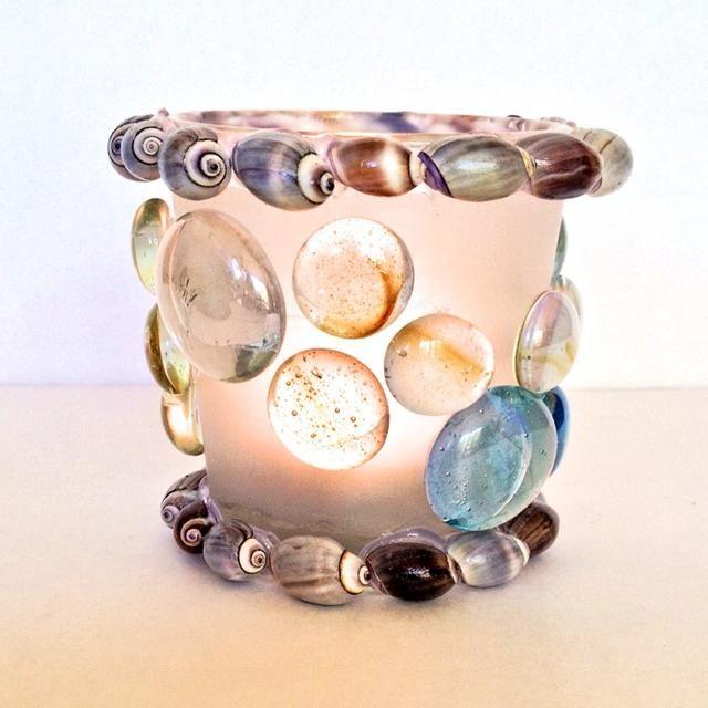 Caracoles oliva conchas y perlas de vidrio
