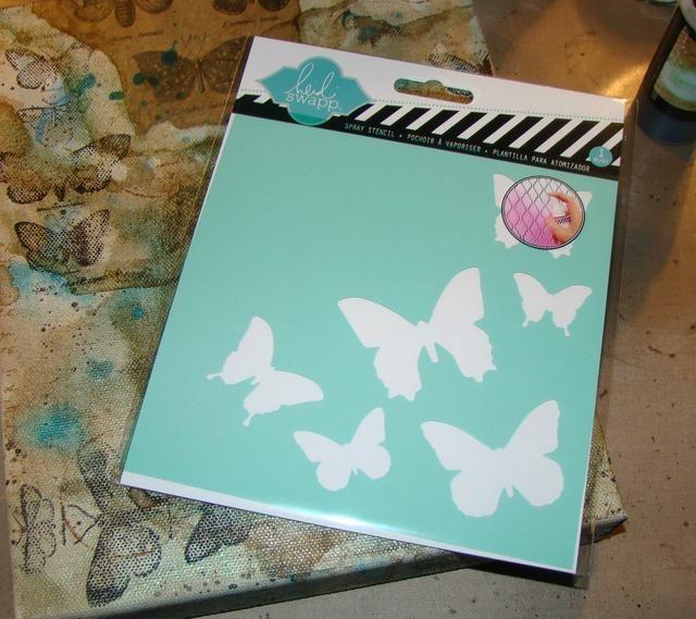 Utilizando modelos de pasta y mi mariposa de la plantilla Heidi Swapp, aplique mariposas al azar en todo el lienzo. Después de estarcir volví y añadí más pasta de alas de dimensión. Seque completamente.
