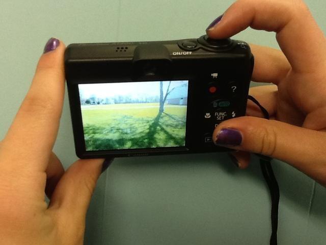 Presione el botón superior para capturar una imagen. Sólo presione una vez, ya que sólo toma un segundo!