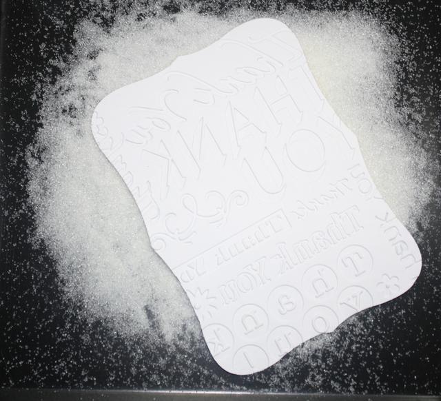 Presione agradecimiento etiquetar en ultra grueso Repujado esmalte o clara polvo que realza. Establecer polvo que realza con pistola de aire caliente.
