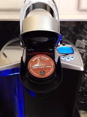Insertar K-Cup y cerca de la cámara
